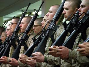 practicing how to handle rifles in barraks.jpg